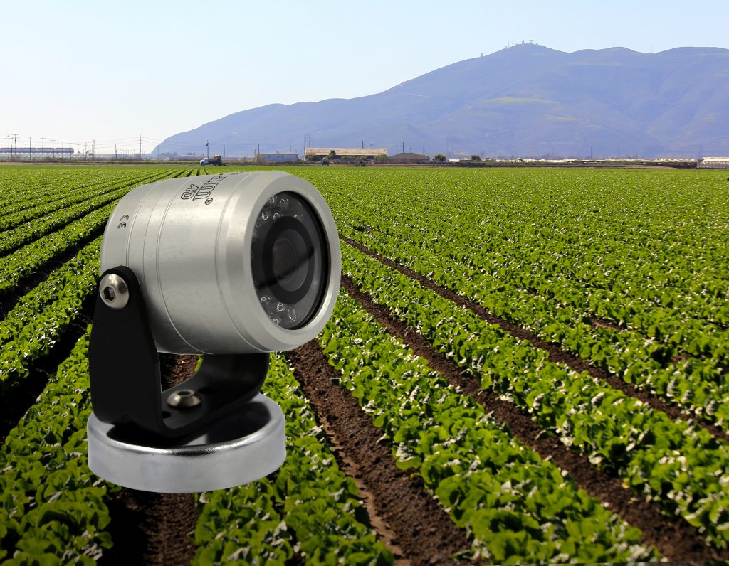 Agcam with green field and mountains in the background